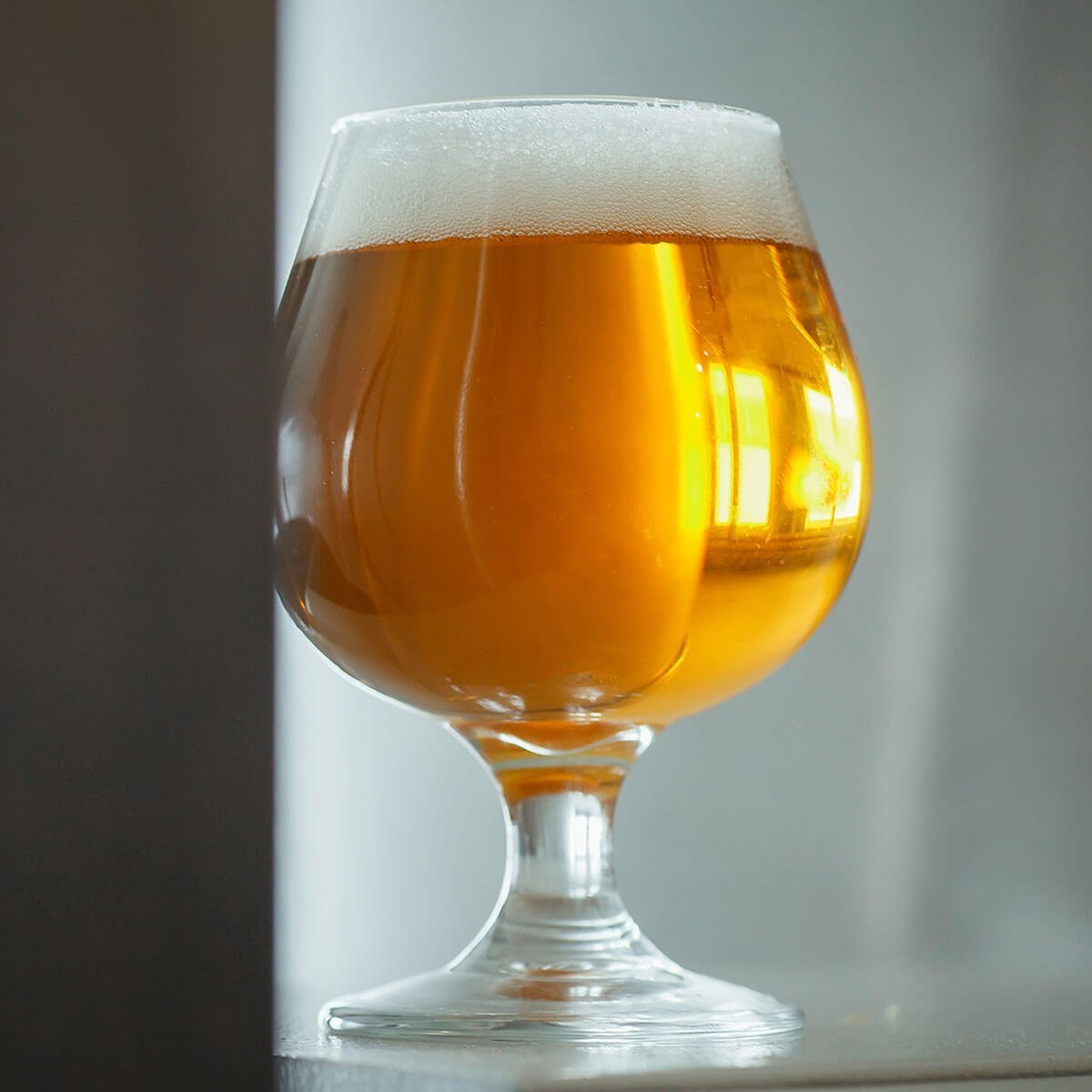 A Berliner Weisse in a Snifter Glass