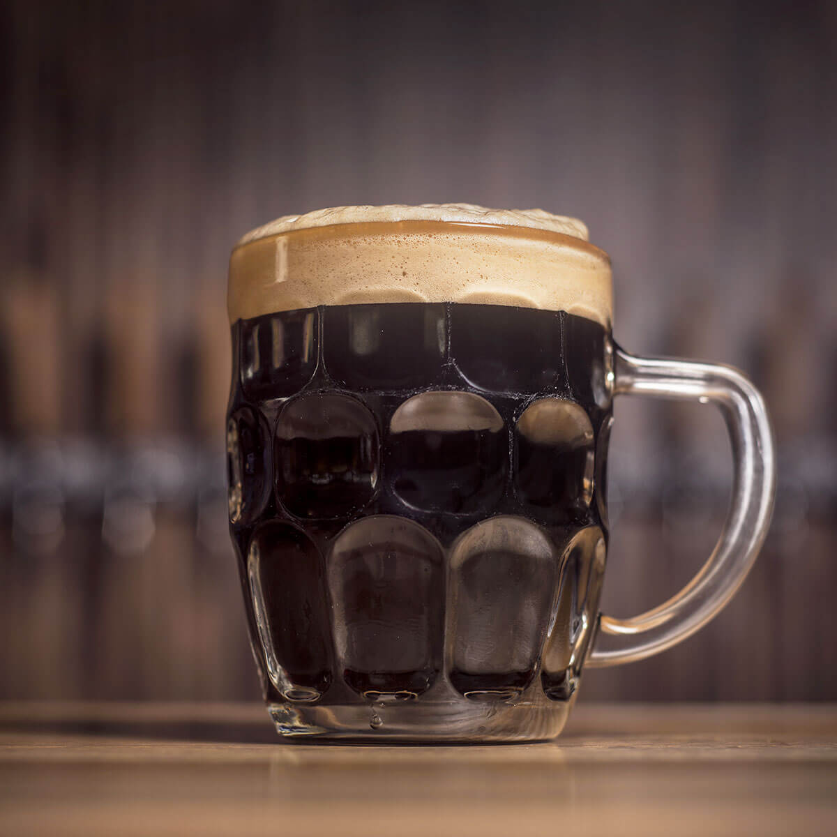 An English Porter in a Dimpled Beer Mug