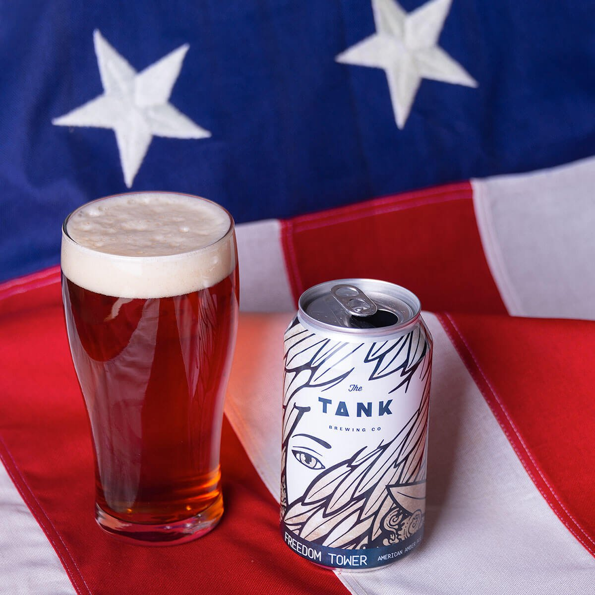 Freedom Tower is an American Amber Ale by The Tank Brewing Co. that showcases floral and citrus hops with caramel and bready malt flavors.